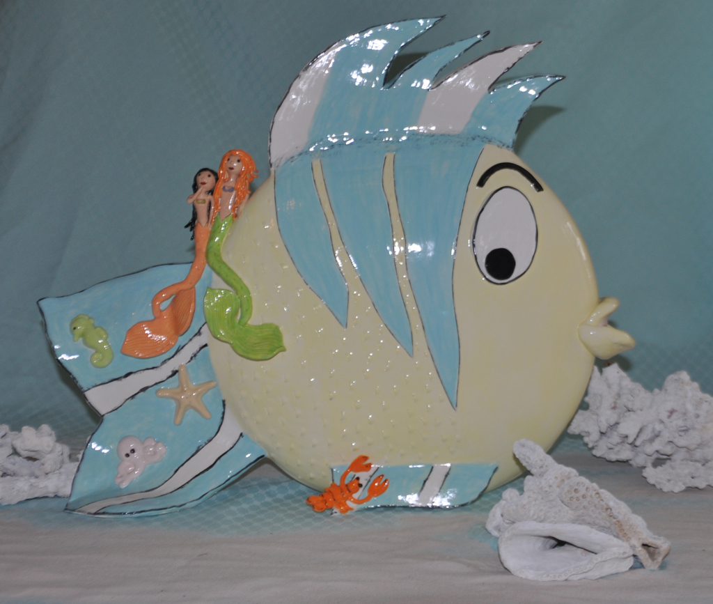 The little mermaid flounder pray for surf sculptures for The little mermaid fish